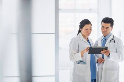 doctors reviewing information on tablet