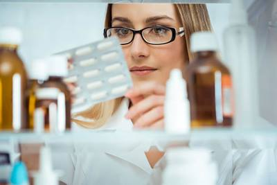 pharmacist looking at medications
