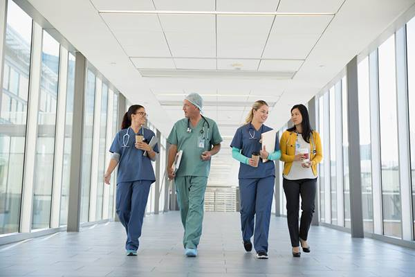 Healthcare staff talking and walking in hospital