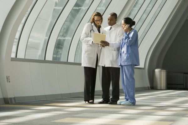 Doctors and nurse reviewing medical chart Edited