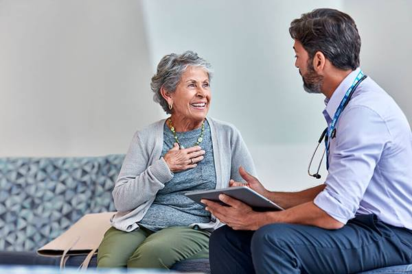 happy patient talking to doctor