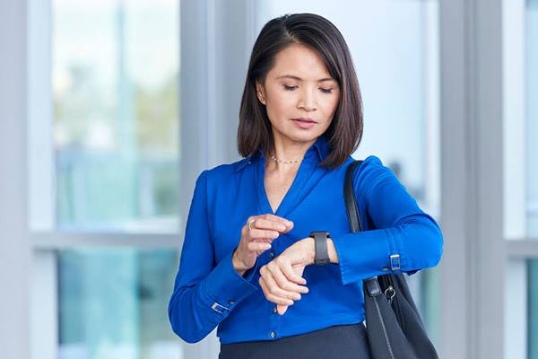 female checking her smartwatch